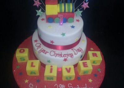 2 Tier multi Coloured Train and Star Cake